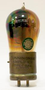 Cunningham C-301-A; brass base with glass tip.
