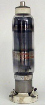 Picture of 678 Thyratron tube with associated four-pin porcelain socket.
