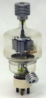 Picture of an Eimac VT-129/304TL tube showing the Eimac-manufactured grid and plate heat sinks attached.
